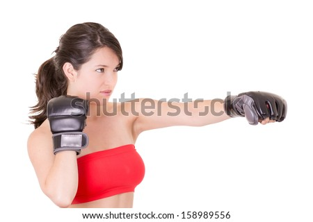 female MMA fighter training white background - stock photo