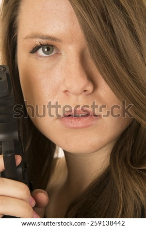 Female model pointing gun very close up - stock photo