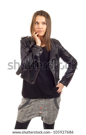 Female model posing in a black leather jacket on white background - stock photo