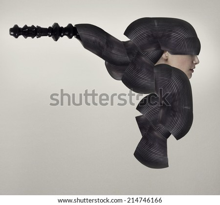 Female model profile in a black bizarre and surreal headgear  - stock photo