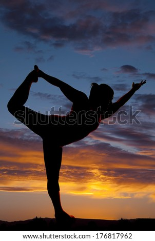 female model silhouette yoga pose sunset background