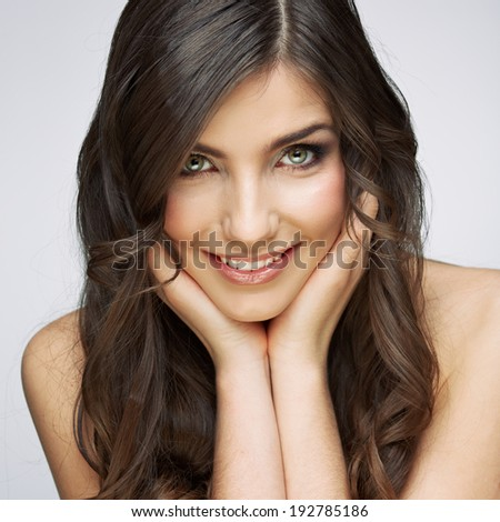 Female model studio posing.Beauty smiling woman face portrait. Close up girl face. - stock photo