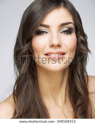 Female model studio posing.Beauty smiling woman face portrait. Close up girl face.