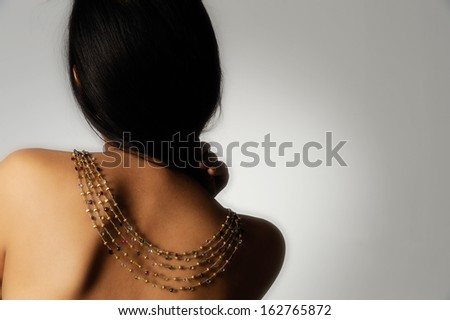female model with golden necklace - stock photo