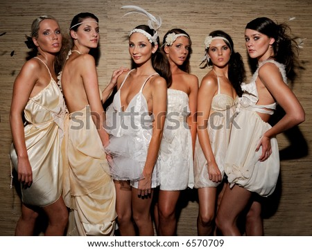 Female models backstage before fashion show - stock photo