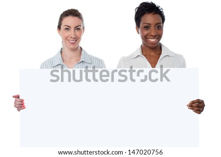 Female models holding blank white billboard