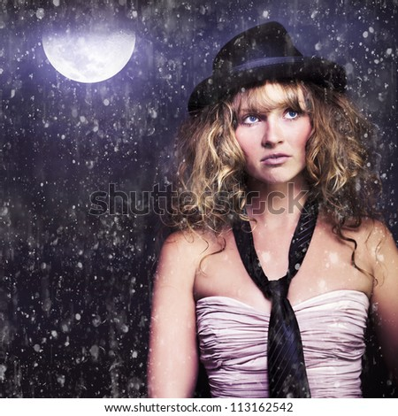 Female Moon Light Night Performer In Bowler Hat And Tie Acting Dancing And Singing During A Creative Rain Musical Drama