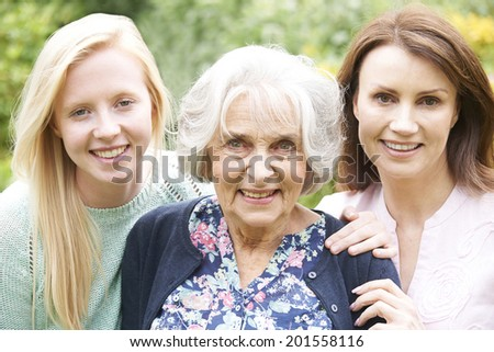 Female Multi Generation Portrait In Garden - stock photo