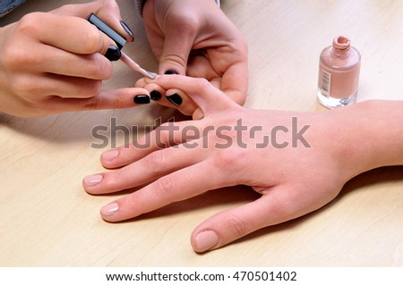 Female nails manicure.