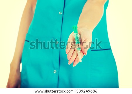 Female nurse hands with a syringe. - stock photo