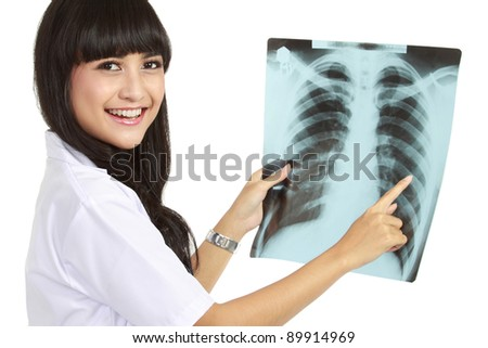 Female Nurse Looking At A Patients Chest X-Ray isolated background - stock photo