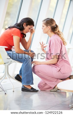 Female Nurse Offering Counselling To Depressed Woman - stock photo