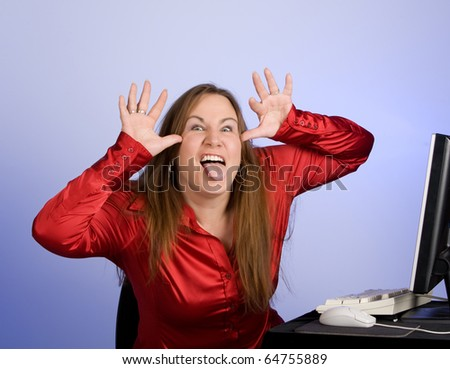 Female office worker making a face while sitting at their desk - stock photo