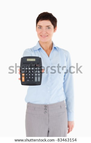 Female office worker showing a calculator against a white background