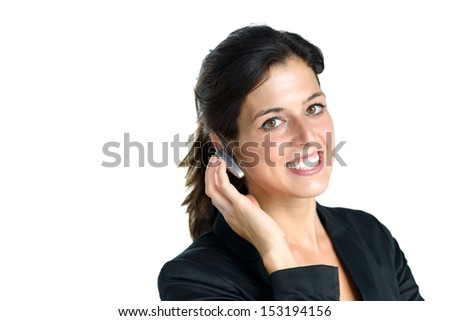 Female operator or receptionist with phone headset for support and marketing sales isolated on white. Caucasian brunette friendly call center girl.
