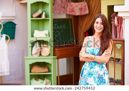 Female Owner Of Fashion Store Standing Outside Shop - stock photo
