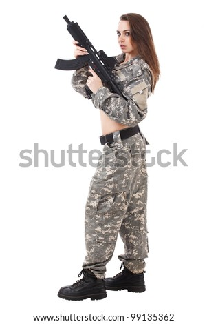 Female paintball player holding the marker - stock photo