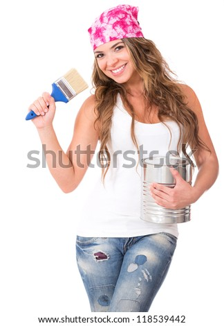 Female painter holding a paintbrush and a paint can - isolated over white - stock photo