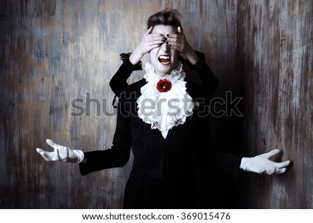 Female palms turn a blind eye to the man vampire. Halloween.  - stock photo