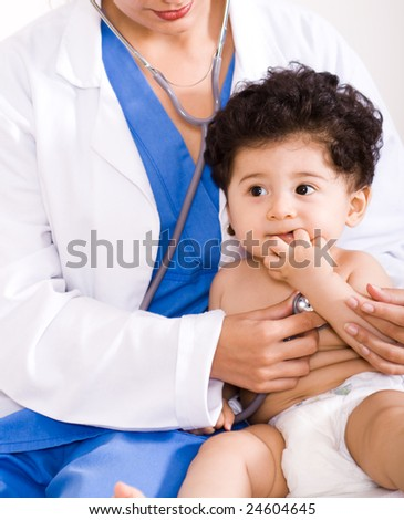 female pediatrician checking cute baby boy - stock photo