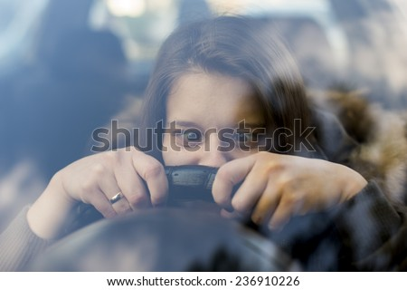 Female person driving a car. Funny face portrait - stock photo