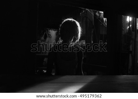 Female person silhouette at abandoned bar