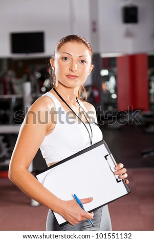 female personal trainer inside gym - stock photo