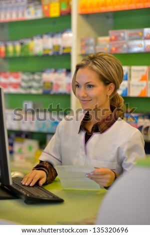 female pharmacist holding prescription - stock photo