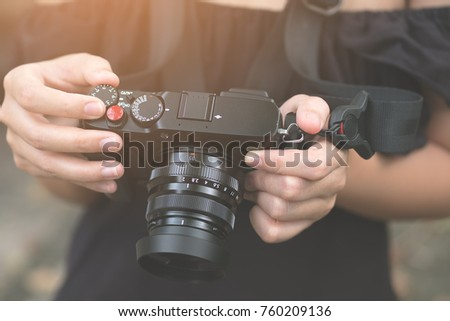 Female photographer, Digital camera on hand, technology,
