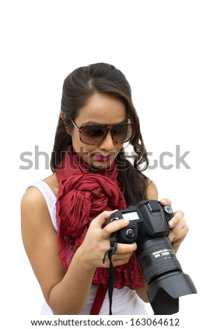 Female photographer holding a camera - stock photo
