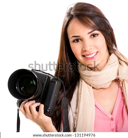 Female photographer holding a camera and smiling - isolated over white - stock photo