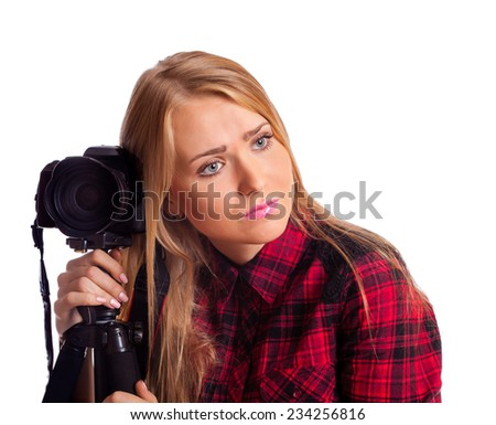 Female photographer relying on tripod tired isolated over white - stock photo