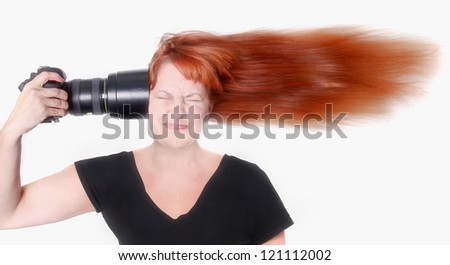 Female Photographer With Camera Pointed at Her Head