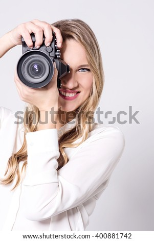 Female photographer with professional camera - stock photo