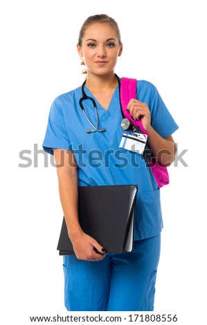 Female physician holding patient records and backpack - stock photo