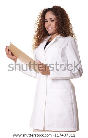 Female physician stands, smiling with a clipboard, isolated on white background.