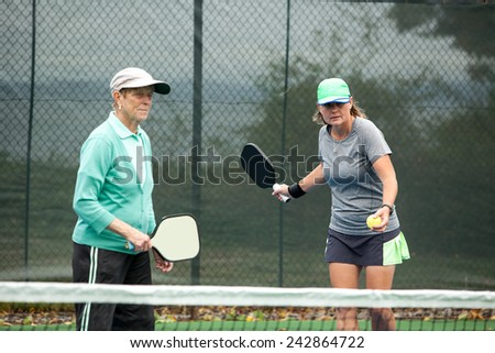 Female pickleball players on an outdoor court - stock photo
