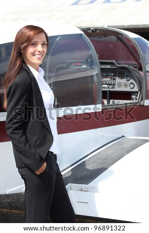 Female pilot and her light aircraft - stock photo