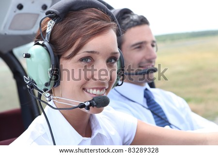 Female pilot of a light aircraft - stock photo