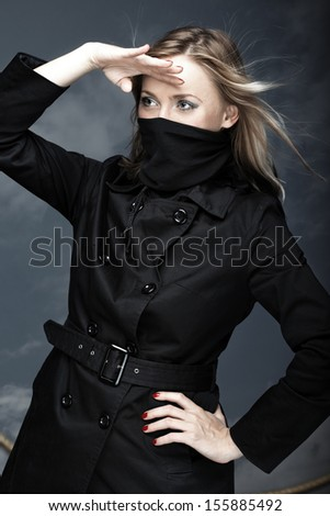 Female pirate on a sky background. Vertical photo - stock photo