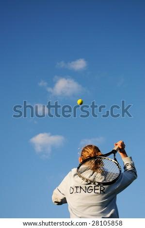 female playing tennis - stock photo