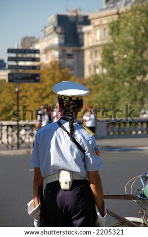 Female police officer from Paris' municipal police - stock photo