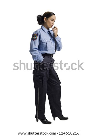 Female police officer talking through her radio - stock photo
