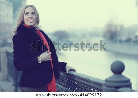 female portrait in cold tones walk city - stock photo