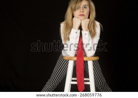 Female portrait leaning on elbows and bar stool - stock photo