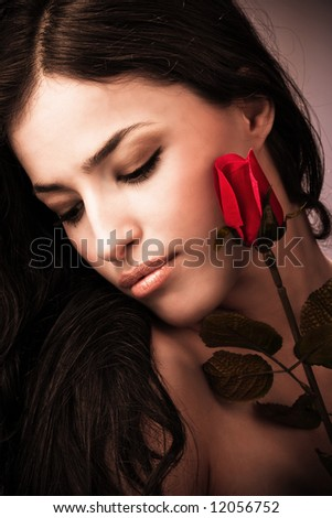 female portrait with rose, studio shot - stock photo