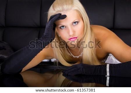 Female posing on black background - stock photo