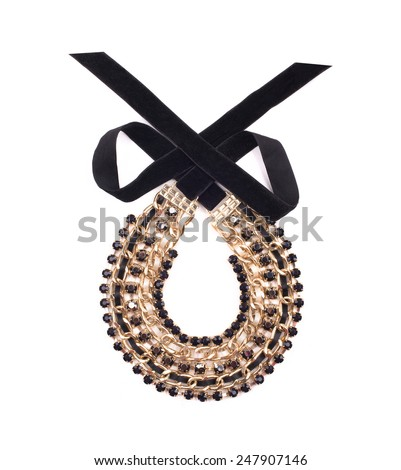 female precious decoration with black ribbon on white background. necklace. - stock photo