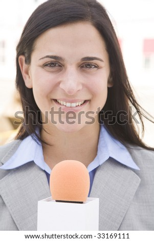 female professional reporting on location