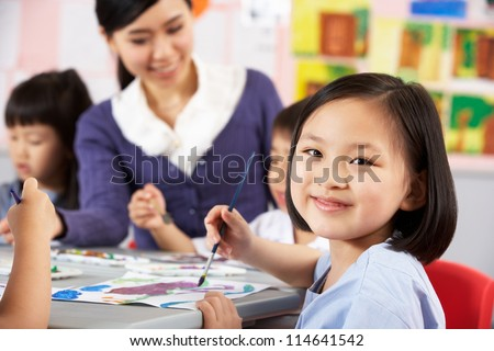Female Pupil Enjoying Art Class In Chinese School Classroom - stock photo
